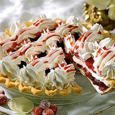 White Chocolate and Cranberry Pie..........This Christmas or winter pie blends layers of tart cranberries with a fluffy white-chocolate mixture. The lattice top is whipped cream.