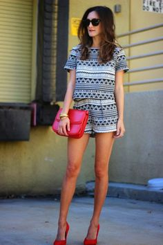 black & white tribal print romper. red heels. red statement pieces. love!