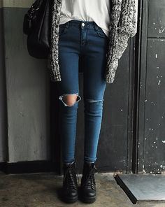 ripped jeans + white blouse + oversized coat + black chunky boots