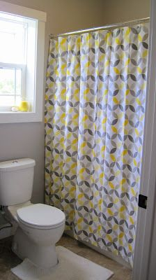 cheerful yellow and grey bathroom