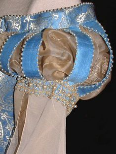 shoulder detail of fairytale medieval wedding gown with pearl embellishment