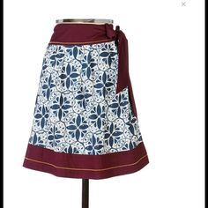 "Anthropologie Edme & Esyllte Talullah wrap skirt Borrowed from Delftware, a blue and white mosaic patterns Edme & Esyllte's wine trimmed wrap around. Hidden button closure, pockets, side tie. Cotton, cotton lining. Machine wash. 22""L. Looks new! Anthropologie Skirts"