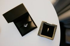 A photo of a handmade personalised wedding ring and a diamond and ruby wedding ring taken before a couples ceremony in Manchester Ruby Wedding Rings, Photography Ideas, Wedding Photography, Personalized Wedding, Weddingideas, Manchester, Cufflinks, Teal, Diamond