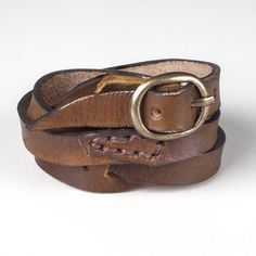 This handcrafted leather bracelet is fairly traded and uniquely designed. The brown leather cuff measures about 1.5 inches wide but can be wrapped wider or thinner depending on your preferred style. It wraps around your wrist with an adjustable metal buckle closure. Made with soft, genuine leather, this bracelet is a durable and versatile accessory. …