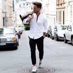 Ready to move on. White shirt and black pants. Menswear for Monday