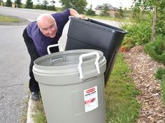 Size does matter when it comes to garbage bins in Barrie - Environmental operations supervisor Sandy Coulter demonstrates how awkward it can be to lift an oversized garbage bin.