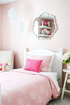 Beautiful pinks for the little princess of the house is dream-worthy in this adorable little girls bedroom.