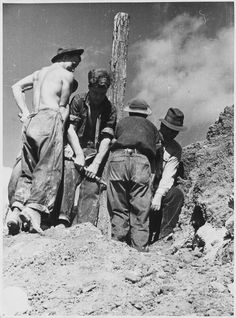Young men of the Civilian Conservation Corps working in loose-cut trousers and brimmed hats, Virginia, c. 1933.