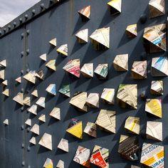 Folded newspaper ads by anna garforth. I love this installation.