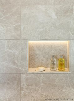 Onslow Square – Gordon Duff & Linton. Natural stone shower niche with LED lighting detail in master bathroom.