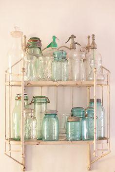 Beautiful rusty shelf with old Ball canning jars.
