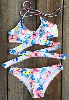 It's time to say yes. Hot sale at $17.99 for the bikini season. Strut your gorgeousness in confidence with this Floral Authority Cross Halter Bikini Set. More sweet swimsuits at Cupshe.com