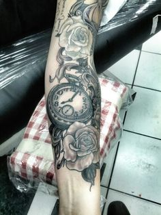 Black and grey pocket watch with roses tattoo. In progress.