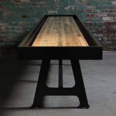 District Millworks out of Los Angeles CA, is hand making custom Shuffleboard tables from reclaimed oak set on steel with industrial era throwback base.