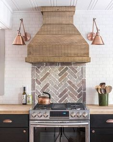 love a brick back splash - it bring some much character into the space and the copper sconces add a warm metallic accent
