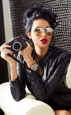 by Moe Levin.. Gold shades, red lips, black leather jacket.. Hot!