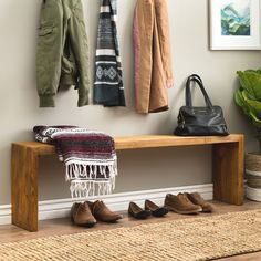 Go for a subtle, classic look with this weathered, rustic pine bench. This rustic pine bench offers ample storage space underneath its seat thanks to its open-bottom design, which is perfect for stori