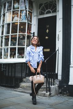 LONDON CALLING. Blue and white ruffle stripe shirt+black ripped jeans+black boots+nude handbag+black hat. Fall Outfit 2016