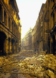 A deserted street in London after an air raid during World War II, Colour Photos from Time & Life Pictures. 'The Blitz' London History, British History, World History, World War Ii, Historia Universal, The Blitz, London Pictures, Air Raid, Battle Of Britain