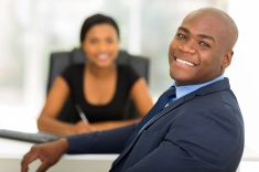 afro american businessman looking back stock photo
