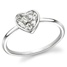 imagine something like this with a pinky-red center stone...  or teal...  or blue.  and with more of a tapered shank.  hmmm  (heart bezel)