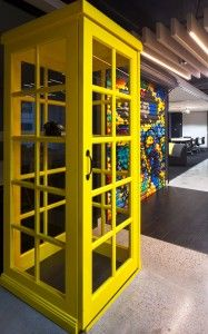 GroupM | The Bold Collective | Office signage, yellow phonebooth, graffiti art, garage door, industrial