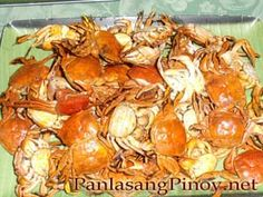 GINATAANG TALANGKA (ASIAN SHORE CRABS IN SPICY COCONUT MILK) = 20 – 30 fresh talangka (Asian Shore Crabs) 8 – 10 gabi (taro) leaves w/ stalks (shredded, wilted) 4 – 5 green native pepper (jalapeno) 5 – 6 cloves garlic, minced 2 tbsp. minced ginger 2 coconuts, grated and extract: 1 cup thick cream and 2 cups thin cream 1 tsp. vetsin or MSG 1 medium sized onions, minced salt to taste ===