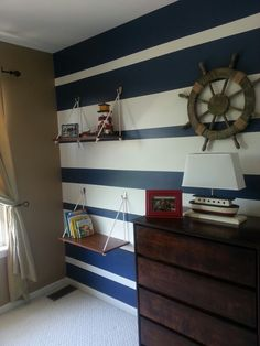 We just redid my son's room into a nautical theme. I saw these DIY shelves and thought we would try it! They came out awesome!