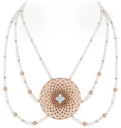 Louis Vuitton Voyage dans le temps Monogram Infini necklace, based on the form of a mandala.  Via The Jewellery Editor.