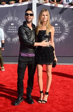 dam Levine, left, and Behati Prinsloo arrive at the MTV Video Music Awards at The Forum on Sunday, Aug. 24, 2014, in Inglewood, Calif.