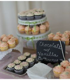 cupcake display with chalkboard sign