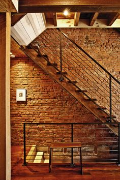 South Philly Factory Building Renovation: exposed brick wall stairway with accent lighting and metal stair railing | Craftwork Design/Renovations