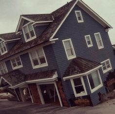 house sinking in the sand