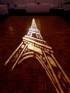 Parisian theme wedding with Eifel Tower gobo dance floor projection at the Grandview Poughkeepsie NY. HourglassLighting.com