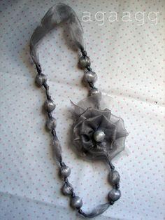 A girl and a glue gun: hot glue necklace.
