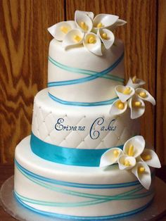 Tiffany Blue Wedding Cake with Calla Lilies. Pretty close to the Malibu color. Use purple instead of yellow