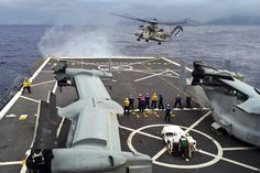 CH-53 Super Stallion approaches landing deck with V-22 Ospreys. Awesome.