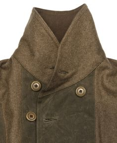 The West is Dead  Mackinaw Jacket Fall 2012  www.thewestisdead.com----    Heavy military inspired wool coat. 100% cotton duck canvas lining with wax canvas accents. Slim fitting shoulders and arms. Welt pockets, corozo nut buttons.   MADE IN THE USA
