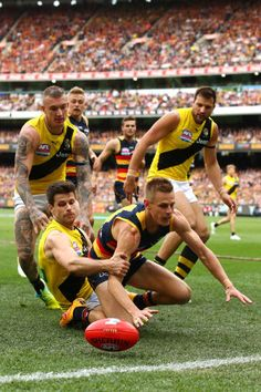 David Mackay of the Crows loses the ball over the boundary line during the 2017 AFL Grand Final match between the Adelaide Crows and the Richmond. Richmond Afl, Richmond Football Club, Soccer Guys, Pro Cycling, World Of Sports, Dream Team, Rugby, Athletes, Finals