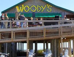 Located on Galveston's west end, Woody's Bar is a full-service, open-air bar featuring great drink specials, live music, pool, and one of the most spectacular Gulf views on the Island.