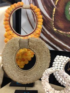 Orange and sand colored necklace art