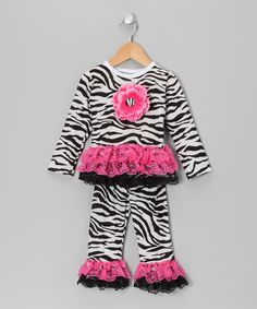 Too cute for only $28.99.Take a look at this Black Zebra Stripe Ruffle Top & Pants - Infant, Toddler & Girls by Tutus by Tutu AND Lulu on #zulily today!