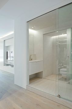 White bathroom with glass sliding doors, Moscow by Ai Design studio _