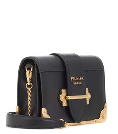 8033c65d543f Opt for an instant icon with Prada s Cahier leather shoulder bag.