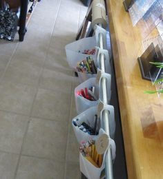 Using old milk bottles for additional storage for crayons, rolls of paper, etc.