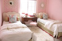 I love this girls room especially because it was pulled together for less than $250. And it happened my favorite way - with lots of DIY and a healthy dose of bargain and thrift shopping.  For example the duvet covers were made with two flat sheets from Wal-Mart and vintage trim was sewed onto the tops of the covers.