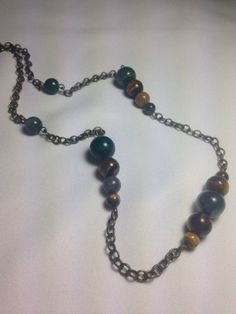 Beautiful Natural Stone Necklace. Hand made with polished Agate, Jasper and Tigers eye individual stones. Chain necklace with distressed vintage look. Perfect for the Fall season a and must have to compliment the warm tones of the season. Length Approx 24