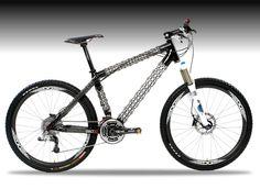 Delta 7!  high performance lightweight mountain bike frame. Carbon fiber and Kevlar spider web-like open lattice tube design. Wow!