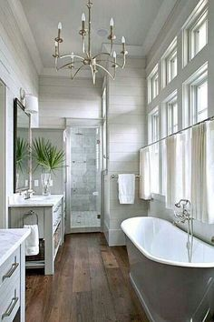 Greay vanities, marble counters - also like vertical tiles on wall for master