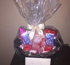 Valentine's Day basket for him! Chocolates, vday monkey, vday card and hockey tickets! You can never go wrong with boys and sports! <3